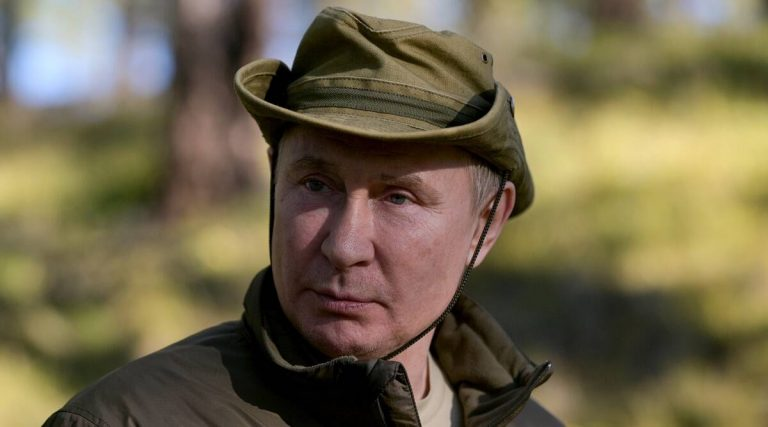 Caught on camera: Kremlin releases photos of Putin's Siberian fishing trip