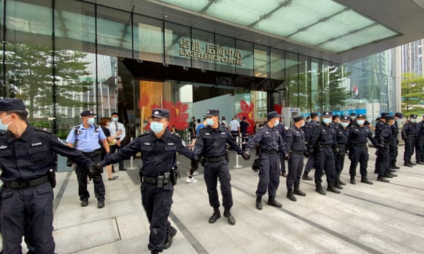 China property giant Evergrande admits debt crisis as protesters besiege HQ